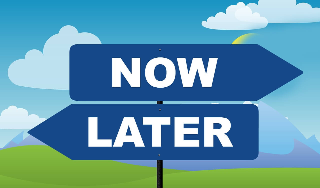 A sign showing options of now or later